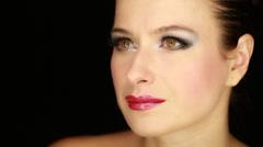 Caucasian female fashion model face black background Stock Footage