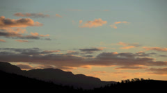 Timelaspe of clouds at sunset over the Flinders Ranges in Australia Stock Footage