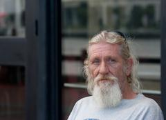 Homeless man with beard Stock Photos