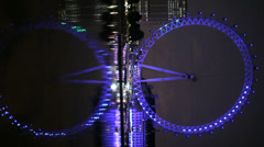London Eye reflected in the Thames Stock Footage
