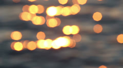 Bokeh of  the sun glares reflected from sea water Stock Footage