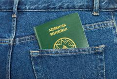 azerbaijan passport in the back jeans pocket - stock photo