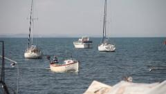 Small Fishing Boat Docked On The Shore Stock Footage