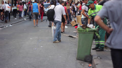 A guy cleanig the street of Sao Paulo Brazil Stock Footage