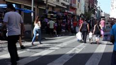 People buying stuffs in street of Sao Paulo Brazil - stock footage