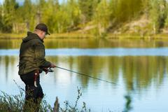 Stock Photo of fisherman and landscape