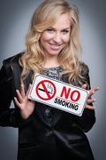 Woman with no smoking sign. Stock Photos