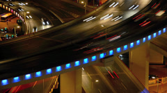Close-up timelapse of traffic at night on busy ring road in Shanghai, China Stock Footage