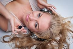 pretty woman with headphones. - stock photo