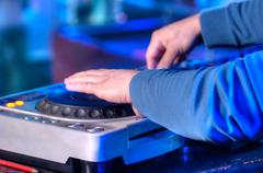 Dj mixes the track in the nightclub at a party Stock Photos