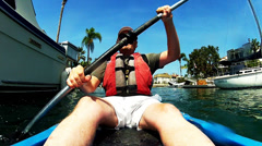 Mature Man Kayaking Past Yachts Boats On Naples Island Canals Stock Footage