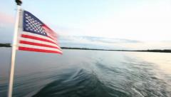 American Flag on Boat with Sunset Stock Footage