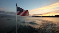 American Flag on back of boat Stock Footage