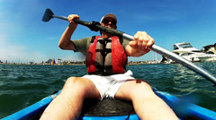 Middle Aged Man Kayaking By Yachts, Boats On Alamitos Bay Stock Footage