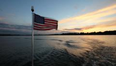 American Flag on the back of boat Stock Footage