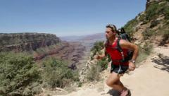 Running cross-country runner man in Grand Canyon Stock Footage