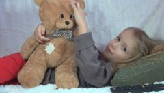 Sick, Ill Child , Little Girl Playing with Teddy Bear on Sofa, Children Stock Footage