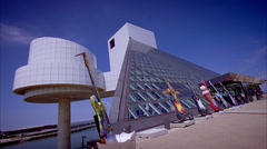 Cleveland - Rock-N-Roll Hall of Fame. Locked off low wide angle left profile. Stock Footage