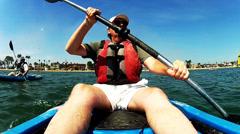 Two Middle Aged Men Kayaking On Alamitos Bay Stock Footage