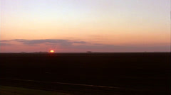 Tracking shot left to right of farmhouses with sunset Stock Footage