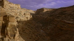 Helicopter shot of Southwestern desert mountain range Stock Footage