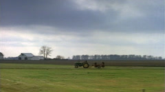 Tracking shot of crops, farm vintage tractor - stock footage