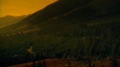 Tracking shot right to left of Colorado Rockies at sunrise Stock Footage