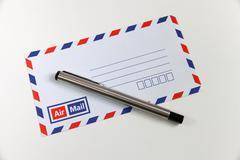 Envelope and pen Stock Photos