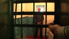 Prisoner in solitary confinement Stock Footage
