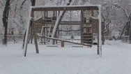 Stock Video Footage of Snowing over Empty Playground, First Snow Fall in Park, Winter, No Children