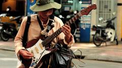 Blind street artist plays guitar Stock Footage