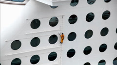 Maintenance workers reparing  the ship Stock Footage