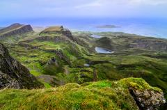 Scenic view of green quiraing coastline in scottish highlands Stock Photos