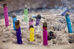 Burning incense in urn Stock Photos