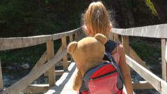 Child Walking on a Bridge over a Mountain River, Tourist in a Trip, Children - stock footage