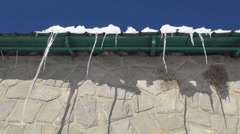 Long Melting Icicles on Roof of a Rural House, Snow and Icicles on Chalet Top Stock Footage