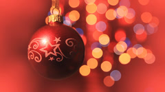 Christmas ball rotates at the background of blurred night lights - stock footage