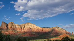 4K UHD NTSC The Sedona mountain range with cloud shadow play Stock Footage