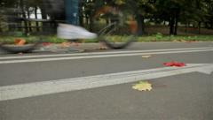 Bicycle arrow sign on the road, bicyclist. Autumn. Slider shot - stock footage