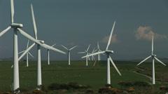 Wind turbines and farm - stock footage