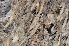 Yksityiskohtaisesti, maankuoren vääntymisen tulivuoren rhyolite kiviä Kuvituskuvat