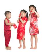 Asian children peeking into red packet Stock Photos