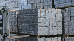 Forklift moves aluminum Scrap Cubes for recycling Stock Footage