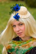 Attractive woman with a beautiful headdress Stock Photos