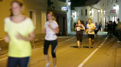 Winner catching up with last runners at Night run Vrhnika 2013 Stock Footage