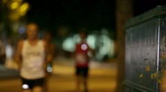 Running behind the corner at Night run Vrhnika 2013 Stock Footage