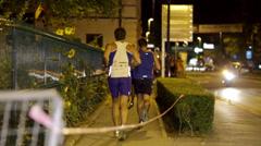 People on street running at Night run Vrhnika 2013 Stock Footage