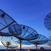 satellite dish at dusk - stock photo