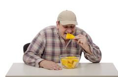 Farmer eating yellow watermelon cut pieces - stock photo