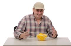 Stock Photo of Chap in baseball cap likes yellow watermelon